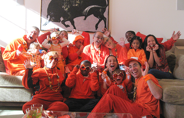 Family Traditions — Creating the Best Holiday Ever; 20 Family Members Dressed Head to Toe in Orange Plus 50 Stuffed Monkeys Is a Good Start
