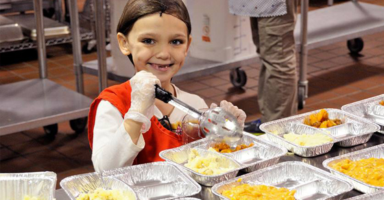 A volunteer works in the Aid For Friends kitchen.